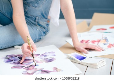 inspiration art creation. painting hobby. woman drawing beautiful floral watercolor design