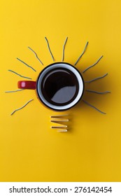 Inspiration concept coffee cup light bulb metaphor for good idea