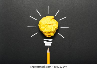 Inspiration concept crumpled color paper light bulb metaphor for good idea