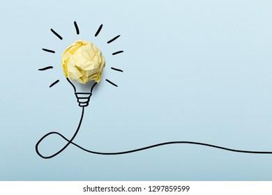 Inspiration concept crumpled paper light bulb metaphor for good idea.