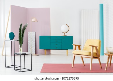 Inspiration for a designer living room interior color scheme with a modern, turquoise blue sideboard and industrial, marble counter tables