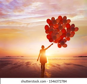 inspiration, dream and creativity, happy life, woman with many balloons at sunset