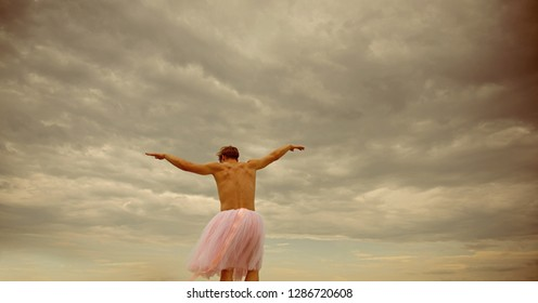 Inspiration and dreaming. Funny man freak. Crazy ballerina. drag queen. Man dancing in tutu in ballet studio. Man in ballerina skirt outdoor. time to relax. Dance cloth shop. Feel freedom