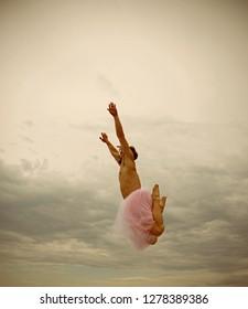 Inspiration and dreaming. Man in ballerina skirt outdoor. Funny man freak. Crazy ballerina. drag queen. Man dancing in tutu in ballet studio. i am free. he loves dancing. i believe i can fly