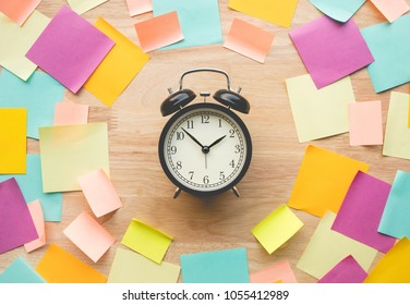 Inspiration ideas concepts with watch and colorful notepaper on wood table.nobody