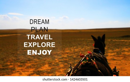 Inspiration Motivational quote - Dream Plan Travel Explore Enjoy with the horse at Xilamuren Grassland, Inner Mongolia blur background.