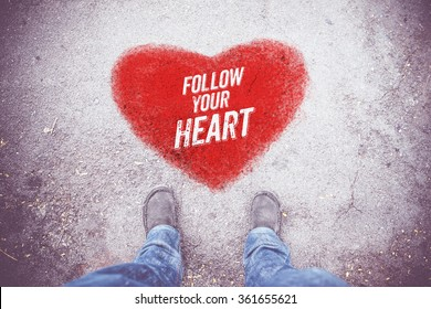 "Inspiration quote : "" Follow your heart "" on aerial view of shoe on road with red heart ,Love Motivational typographic."