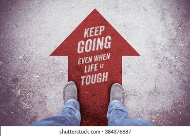 "Inspiration quote : "" Keep going even when life is tough"" on aerial view of shoe on road with move forward red arrow ,Motivational typographic."