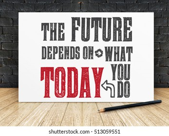 "Inspiration quote : ""The future depends on what you do today"" on white frame in black brick wall and wooden flooring ,Motivational typographic."
