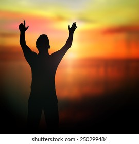 Inspirational concept: Silhouette of victory man with hands raised to beautiful sunset nature background - Shutterstock ID 250299484