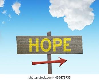 Inspirational Hope sign on sky background