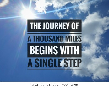 Inspirational life quote on the blue sky background. The journey of a thousand miles begins with a single step