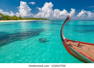 Inspirational Maldives beach design. Maldives traditional boat Dhoni and perfect blue sea with lagoon. Luxury tropical paradise concept