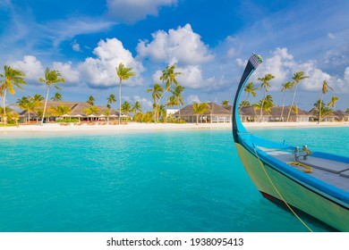 Inspirational Maldives beach design. Maldives traditional boat Dhoni and perfect blue sea with lagoon. Luxury tropical resort hotel paradise view. Idyllic coast, shore with white sand, palm trees