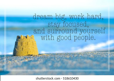 Inspirational motivating quote on blur beach view with sand castle. Dream big, work hard, stay focused, and surround yourself with good people.