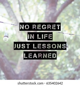 "Inspirational motivating quote on blur background, ""No regret in life. Just lessons learned"""