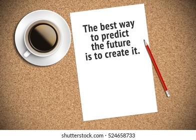 Inspirational motivating quote on paper with coffee, pencil and cork background. The best way to predict the future is to create it.