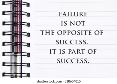 Inspirational motivating quote on spring white note book.Failure is not the opposite of success. it is part of success.