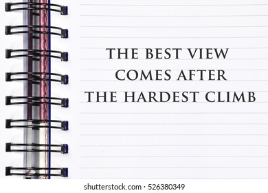 Inspirational motivating quote on spring white note book. the best view comes after the hardest climb