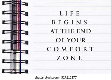 Inspirational motivating quote on spring white note book. life begins at the end of your comfort zone