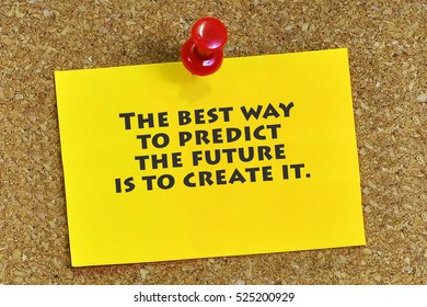 Inspirational motivating quote on sticky note paper with cork background. The best way to predict the future is to create it.