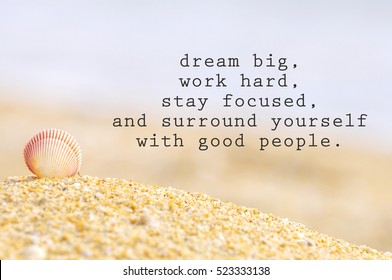 Inspirational motivating quote of shell clam on the sand at the beach. Dream big, work hard, stay focused, and surround yourself with good people.