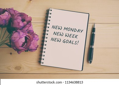 Inspirational and motivation life quote on note pad - New Monday, New week, new goals. Retro style.