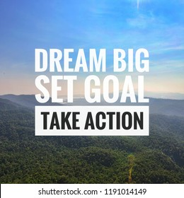 Inspirational motivation quote 'dream big set goal take action' on the mountain sunset background