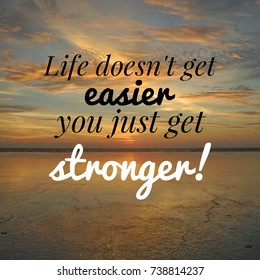 Inspirational motivation quote LIFE DOESN'T GET EASIER YOU JUST GET STRONGER! on sunset sky clouds  background.