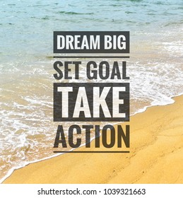 Inspirational motivation quote on the beach waves background. Dream big set goal take action.