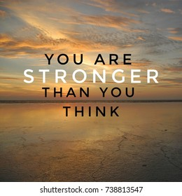 Inspirational motivation quote YOU ARE STRONGER THAN YOU THINK on sunset sky clouds  background.