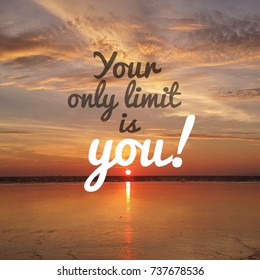 Inspirational motivation quote YOUR ONLY LIMIT IS YOU on nature sunset background.