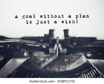 Inspirational and Motivational Concept - 'A goal without a plan is just a wish' with vintage background. Stock photo.