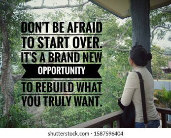 Inspirational motivational quote - Do not afraid to start over. It is a brand new opportunity to rebuild what you truly want. With young woman standing alone  looking at the trees in the forest view.