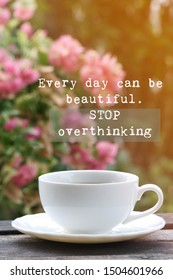 Inspirational motivational quote- Every day can be beautiful. Stop overthinking. Words of wisdom concept. Cup of coffee and blur background.