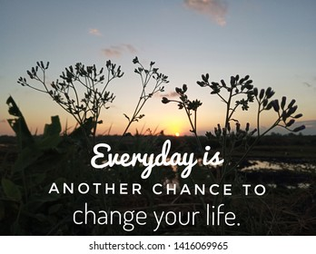 Inspirational motivational quote- everyday is another chance to change your life. With meadow grass flowers silhouette and sunset sunrise background.
