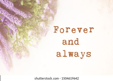 Inspirational motivational quote- Forever and always. Words of wisdom concept. with purple flower background