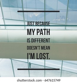 """Inspirational Motivational quote """"just because my path is different doesn't mean I'm lost"""" on  window background."""