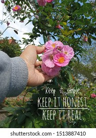 Inspirational motivational quote - Keep it simple. Keep it honest. Keep it real. With young woman hand touch beautiful pink roses flower blossom in the garden. Words of wisdom with nature.