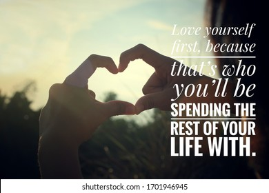 Inspirational motivational quote - Love yourself first, because that is who you will be spending the rest of your life with. With young woman making hand love sign on sunset background.
