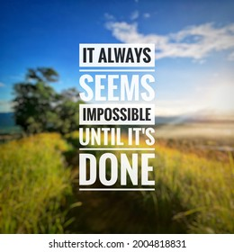 Inspirational and motivational quote on blurred background. It always seems impossible until its done.