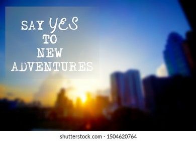 Inspirational motivational quote- Say yes to new adventure.Words of wisdom travel concept.
