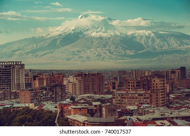 Inspirational mountain view. Yerevan cityscape. Travel to Armenia. Tourism industry. Mount Ararat on background. Armenian architecture. City tour. Urban landscape. Street view. Sightseeing concept.