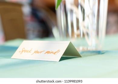 Inspirational name tent; speak your mind