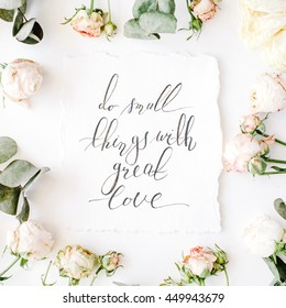 inspirational quote do small things with great love written in calligraphy style on paper with pink roses and eucalyptus branches on white background. flat lay, top view