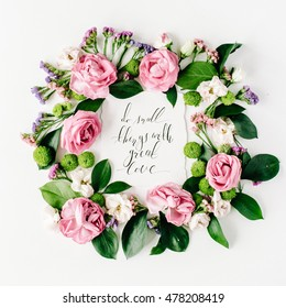 inspirational quote do small things with great love written in calligraphy style on paper with pink, red roses, dried flowers and leaves isolated on white background. Flat lay, top view