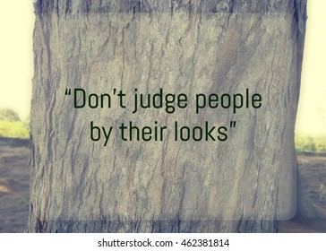 Inspirational quote,  Don't judge people by their looks quote on blurred background with vintage filter