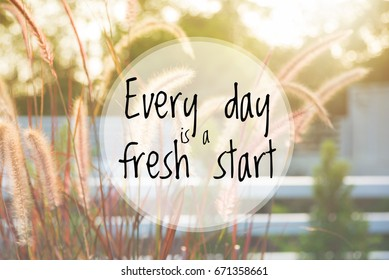 Inspirational quote : Every day is a fresh start over blur background
