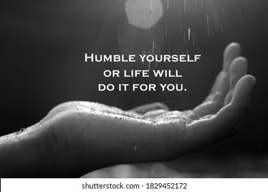 Inspirational quote - Humble yourself or life will do it for you. With open arm hand receiving the light on black and white abstract art background.