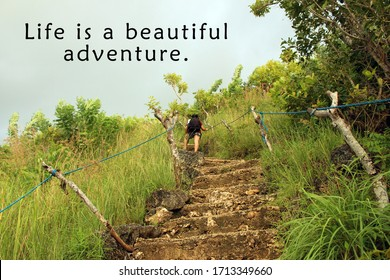 Inspirational quote - Life is a beautiful adventure. With young woman walking on stair of the cliff forest. Enjoy the life journey and life challenge concept.